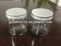 Transparent plastic honey jar with metal cap