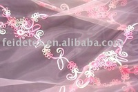 Embroidery on organza fabric