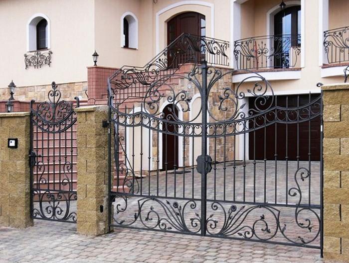 The l gant en fer forg porte d 39 entr e ext rieure de for Porte jardin fer