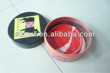 Four tin coaster sets in round tin