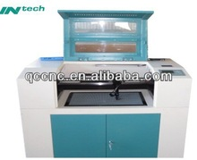 china precision fabric stencil laser cutting machine QC6090 for leather and dress fabric