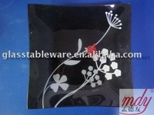 tempered glass dish with white flower