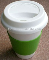 Ceramic cup with silicone lid and sleeve
