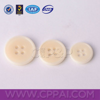 White color natural corozo button with 4 holes