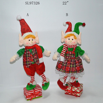 22 Inch Christmas standing plush elf stuffed on shelf with gift bag