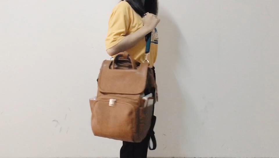 Mochila de piel sintética de primera calidad para pañales, mochila marrón para pañales con almohadilla cambiante, bolsa de pañales de cuero vegano con diseño elegante