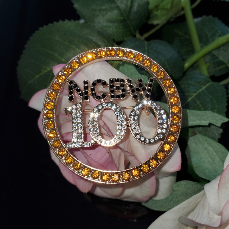 New Round NCBW 100 Gold black and clear crystal pin