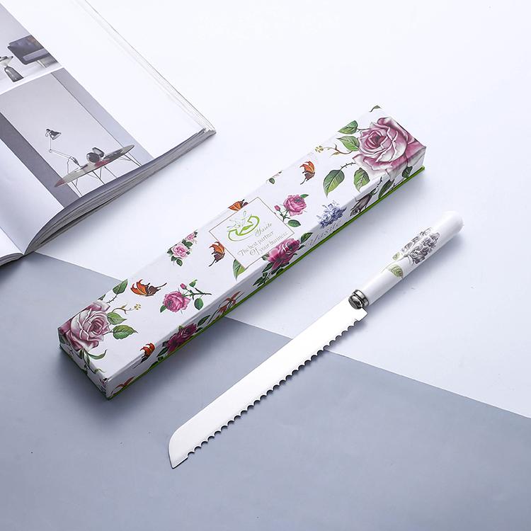 結婚式エレガントな白のセラミックハンドルステンレス鋼キッチン鋸歯状スライサーホテルカスタムパンナイフ