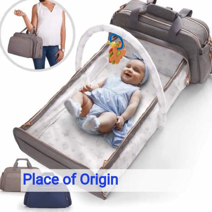 कार्यात्मक हल्के ग्रे नीले 4-में-1 परिवर्तनीय बेबी डायपर बैग बिस्तर