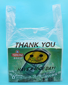 Biodegradable smiley face printed in a thickened plastic T-shirt bag