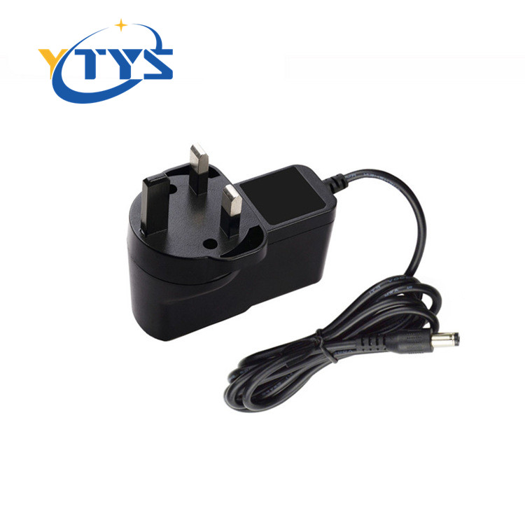 AC/DC adaptor 9v 1a power adapter power supply 9w UK plug