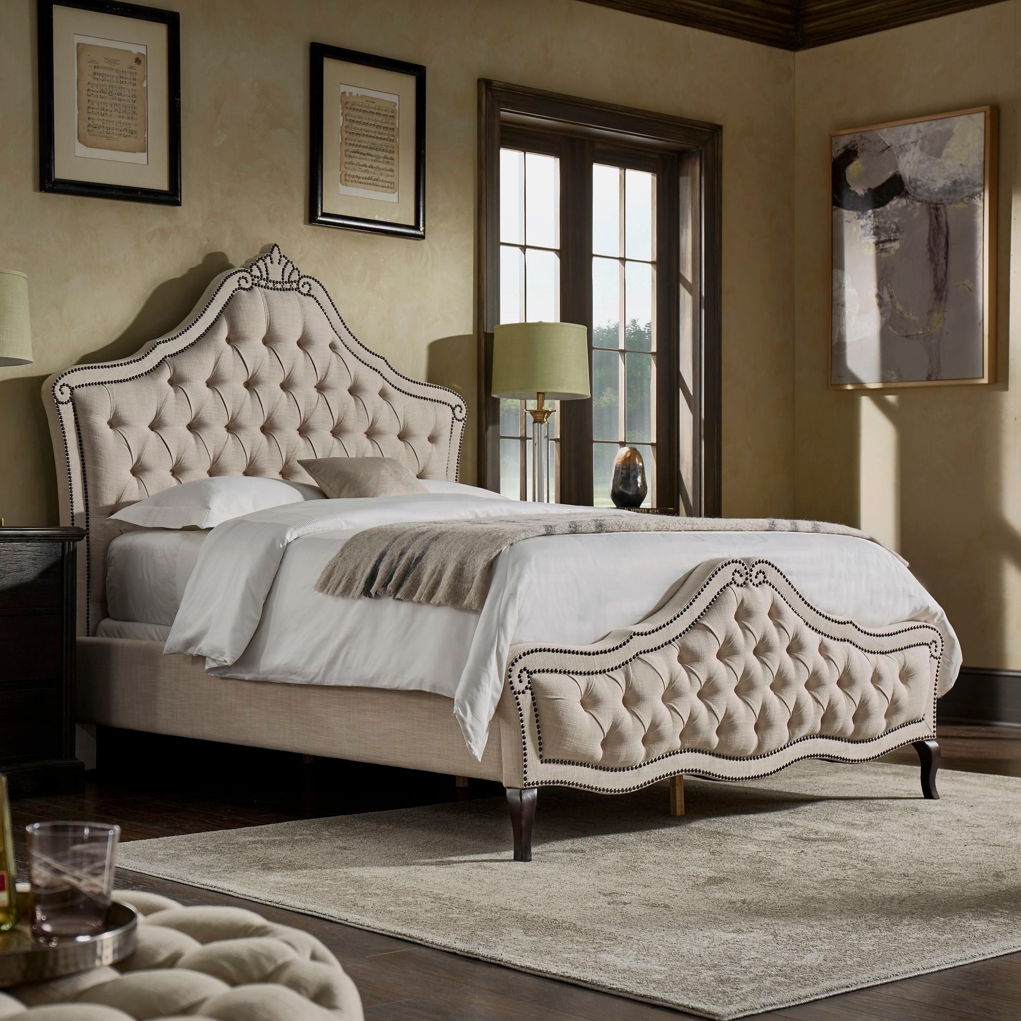 Nessa-Tufted-Beige-Scroll-Bed-with-Bronze-Nailhead-Trim-by-iNSPIRE-Q-Classic-3d7124ce-e324-4377-bd1e-40ae5f5b5afb.jpg