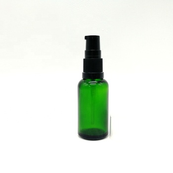 Round green glass bottle with black treatment pump lotion 30ml 1oz