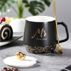 Novelty White And Black Ceramic Coffee Mug with Heart Lid and Gold Spoon for Birthday Gift