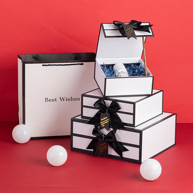 Elegant bespoke logo magnetic close jewelry makeup wallet flip top box packaging with ribbon