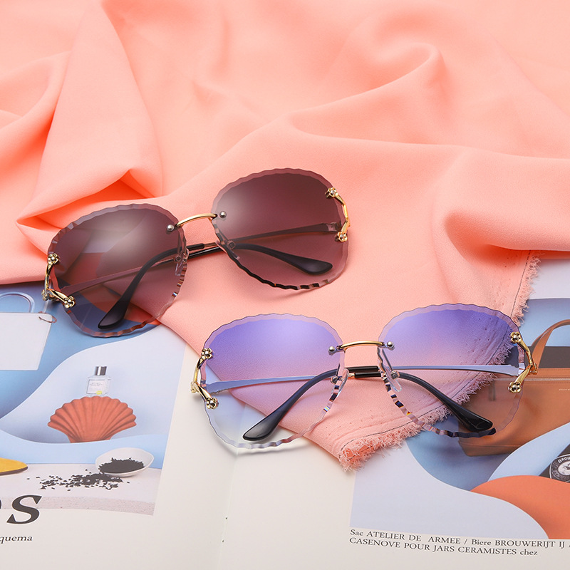 2020 New Arrivals Hollow Out Rimless Lady Sun Glass Photochromic Women Circular Sunglasses