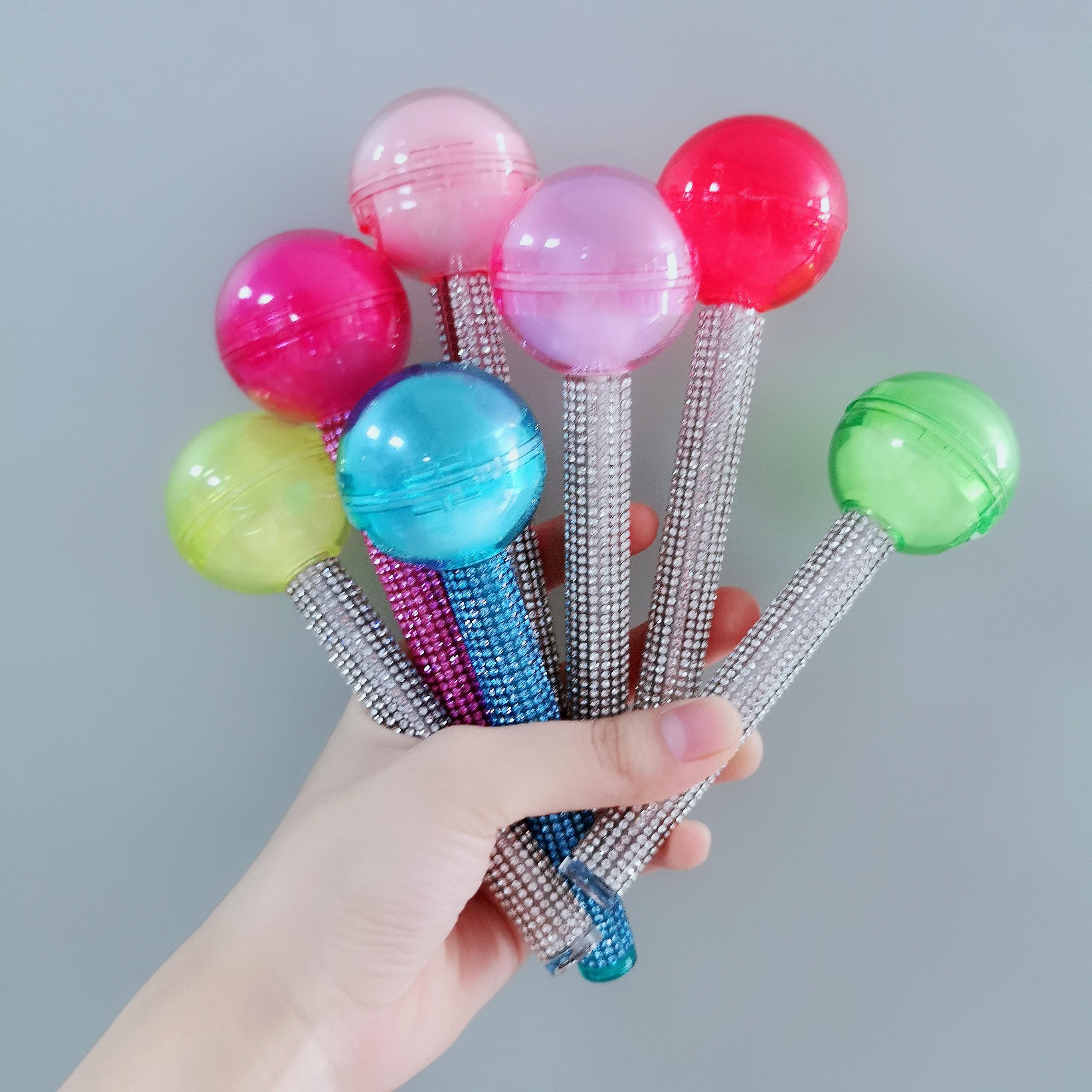 Hot-selling custom fashion jewelry luxury lipstick magical color lollipop lip gloss plastic tube
