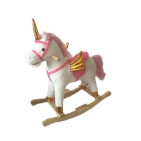 Plush rocking horse with flying wing in golden material, with moving mouth and moving tial