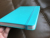 Turquoise covers blind embossed logo hardcover notebooks Ruled pages with elastic band