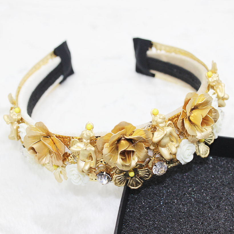 A chaplet for a woman's wedding a garland for a bridesmaid's wedding a gold flower headband on her forehead