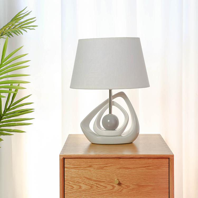 Popular solid geometry design ceramic base bedside night lamp for hotel decor