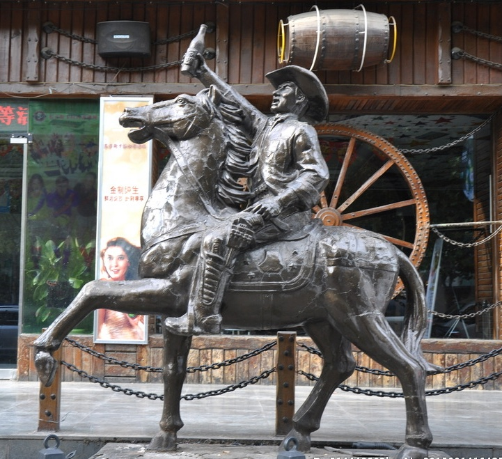 Life size squiffed man riding bronze horse sculpture for outside bar decoration
