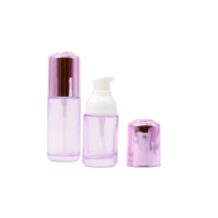 hot sale essential oil use pink frosted glass lotion bottles and jar sets for cosmetic package