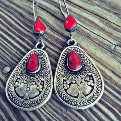 Ruigang europea al por mayor de estilo étnico de pino rojo piedras preciosas de agua declaración tallado pendientes para mujer