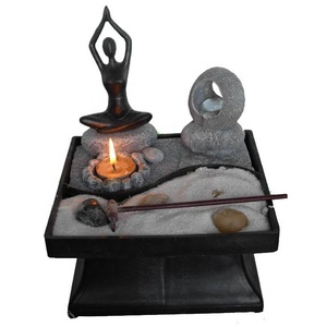 abstract figure candle fountain zen garden
