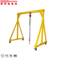 Small mini 500kg 1 2 3 5 ton mobile portable gantry crane price with electric chain hoist