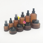 Cosmetic bottle packaging 30ml 60ml empty glass lotion bottle 2oz frosted amber glass bottle with black aluminum pump