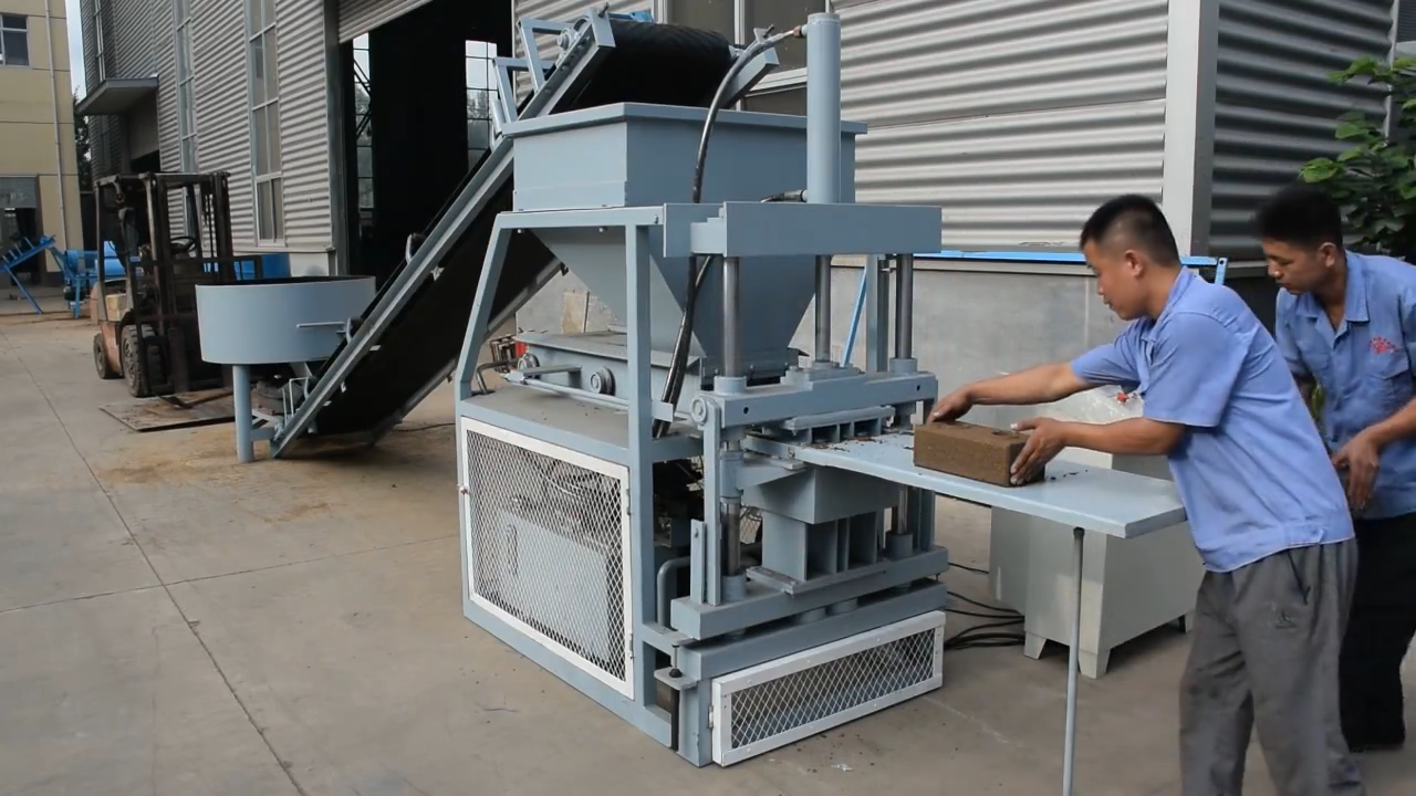 2015 Hydraulic Pressure High Quality Soil /Mud Interlocking Brick Making Machine SY1-10