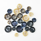 Four-eye resin button pattern two-color flash stick button