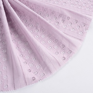 China textile factory wholesale pink fashion 100 cotton cutwork embroidered fabric