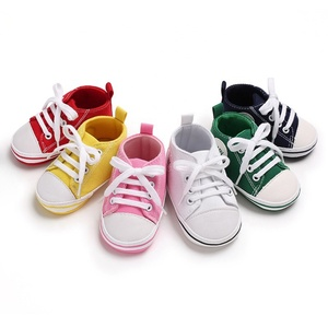 Wholesale green baby handmade shoes canvas baby hard sole walking shoes