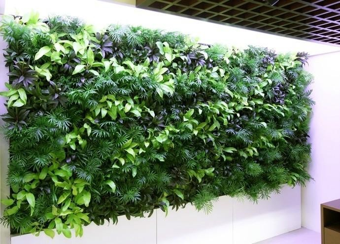Realistic art plant wall garden green artificial wall for Artificial plants for interior decoration