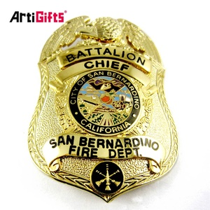 Customized design die struck soft enamel metal pin fire services badge