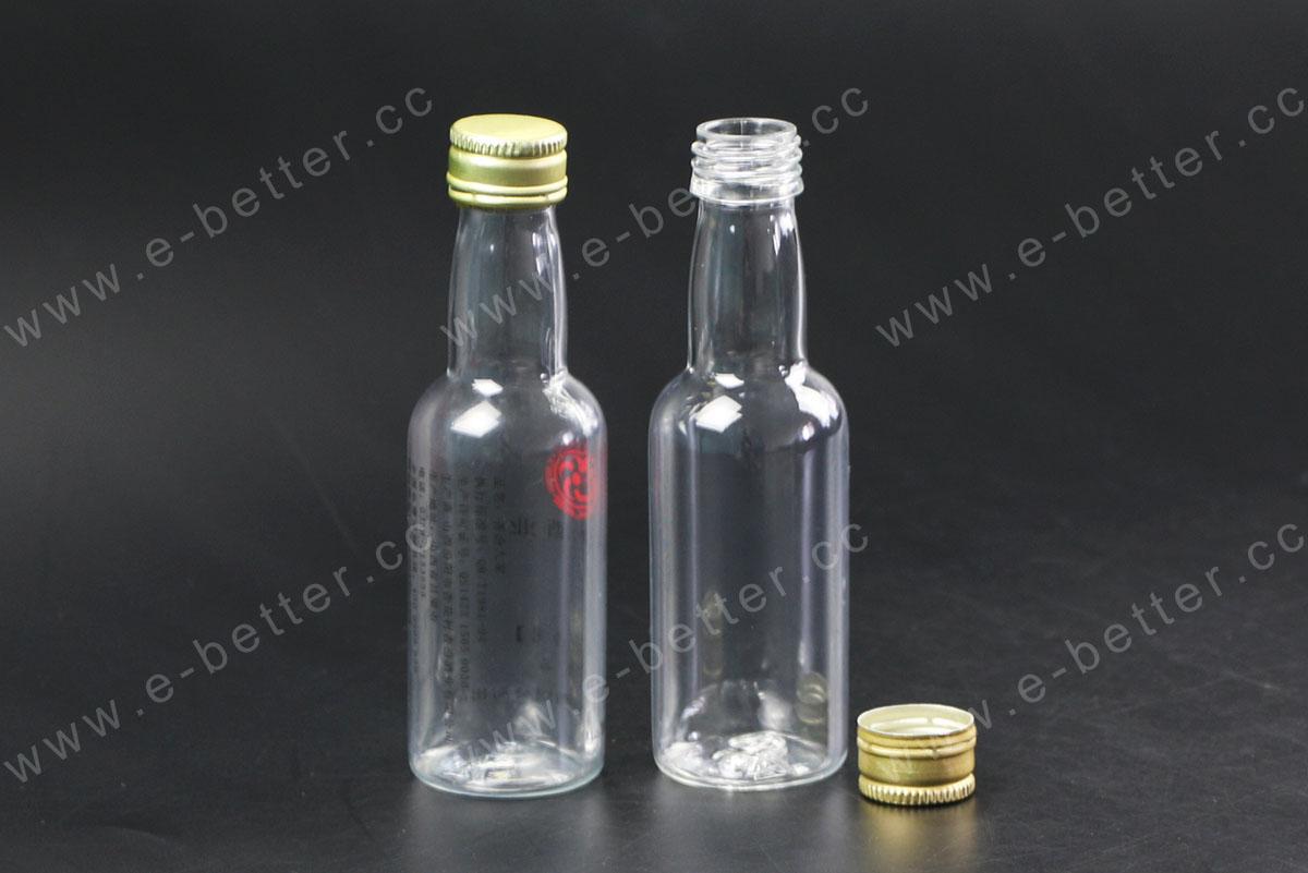 empty small pet plastic wine bottle with pilfer