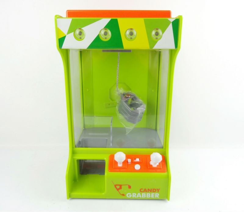 Niniya B/O candy grabber with music&lights,B/O candy grabber machine,promotional toys