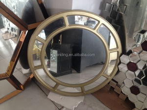 Round Wall Glass Mirror in a Antique Wooden Frame