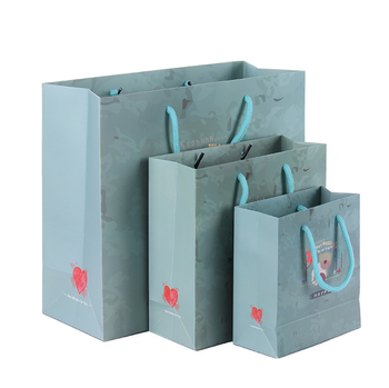 Shenzhen gift packing kraft paper bag with ribbon handle