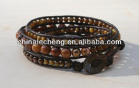 Shell Bead Triple Wrap Leather Beaded Bracelet. Artisan crafted hammered copper button. Coffee and Caramel