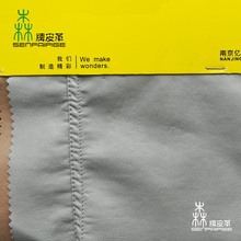 Wet process embossed leather material for garment