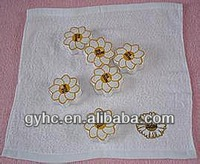 Flower embroidery on white hand towel/compressed sun flower towel