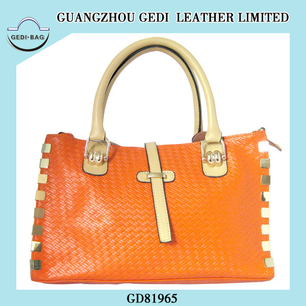 guanghzou designer fashion woven side studded with gold metal handbag manufacturer
