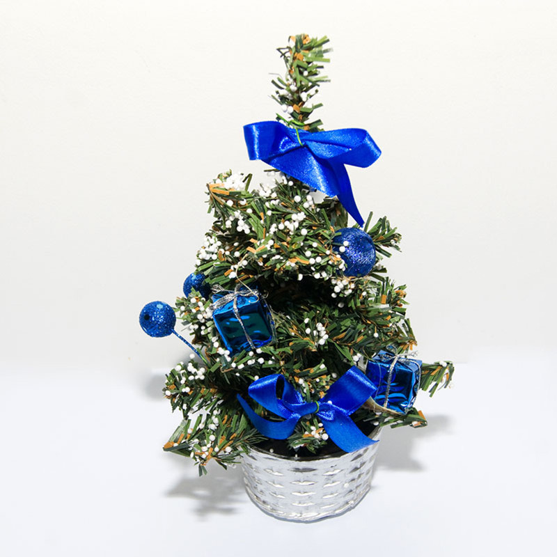 Add The Dash Of Style And Contemporariness To Your Holiday Decor By Adorning Small Christmas Tree With Blue Ornaments Bows