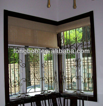 Fancy wrought iron window guard design for home buy for Fancy window design