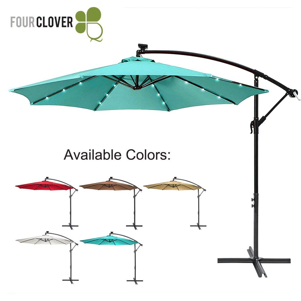 FOUR CLOVER 10 Ft Deluxe Solar 32 LED Lighted Patio Umbrella Offset Hanging Umbrella Outdoor Market Umbrella Garden Umbrella, 250g/sqm Polyester, with Cross Base and Crank (Turquoise)