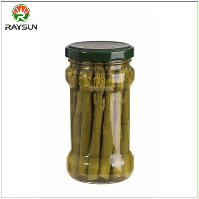 Organic green asparagus in glass jar