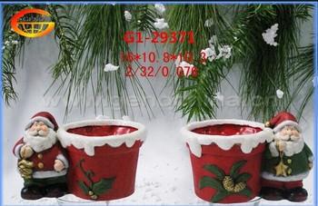 christmas flower pots with santa claus decoration